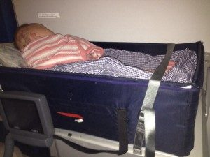flying with a baby travel cot